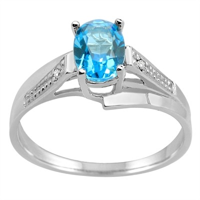 Oval Blue Topaz and Diamond Wave Ring in 10K Gold